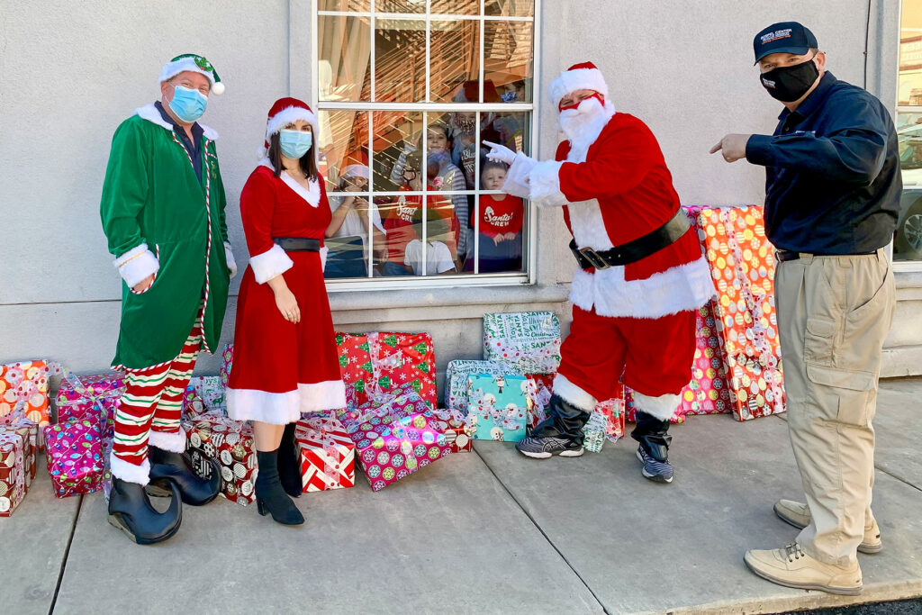 Journey crew delivering presents to GCRM kids